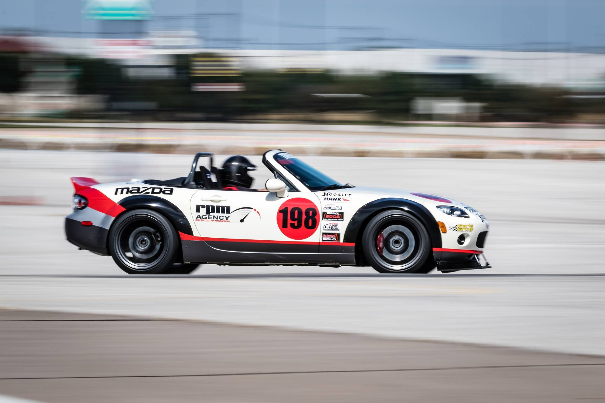 RPM Agency Mazda Race Car racing on track