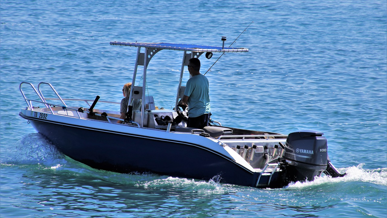Sport fishing boat on the water with two occupants